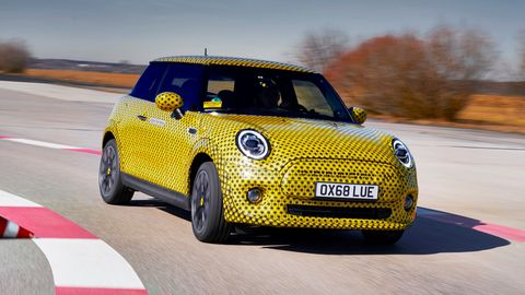Land vehicle, Vehicle, Car, Motor vehicle, Yellow, Mini, Automotive design, Mini cooper, City car, Automotive exterior,