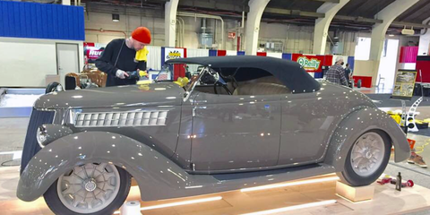 """Land speed racer and hot rodder George Poteet added America's Most Beautiful Roadster winner to his long list of achievements, when his """"3 Penny Roadster"""" 1936 Ford won the title at this year's Grand National Roadster Show in Pomona. Here it is getting the final layer of gleaming car wax before the show."""