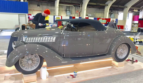 "Land speed racer and hot rodder George Poteet added America's Most Beautiful Roadster winner to his long list of achievements, when his ""3 Penny Roadster"" 1936 Ford won the title at this year's Grand National Roadster Show in Pomona. Here it is getting the final layer of gleaming car wax before the show."