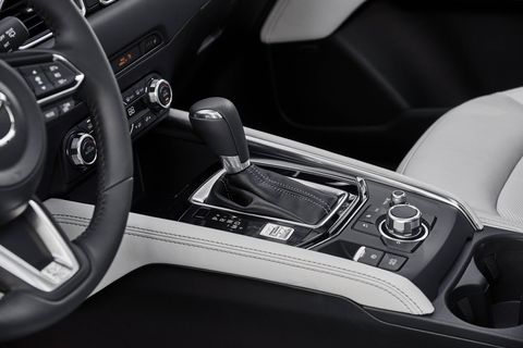 The 2018 Mazda CX-5 comes standard with a leather-trimmed steering wheel and gearshift, and a 7-inch infotainment screen.
