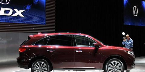 The 2014 Acura MDX gets massaged sheetmetal, new safety and technology features and a front-wheel-drive version for the first time.