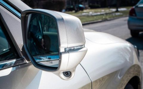 The passenger-side mirror on the 2013 Honda Accord has a camera that is part of Honda's new Lane Watch system.