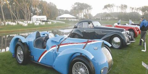 A 1937 Delahaye Type 145 of Merle and Peter Mullin is joined by the 1938 Alfa Romeo 8C 2900B Berlinetta of the Collier Collection and the 1938 Alfa Romeo 8C 2900 MM of Ralph Lauren in the Mille Miglia class display.