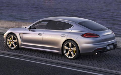 The 2014 Porsche Panamera's restyled rear looks wider with larger rear glass, restyled fascia and larger automatically deploying spoiler.