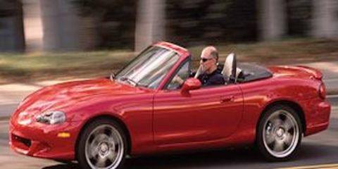 Tire, Wheel, Mode of transport, Automotive design, Vehicle, Automotive mirror, Land vehicle, Red, Car, Performance car,