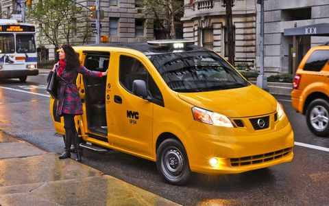 A passenger exits the 2014 Nissan NV200 taxi in New York City.