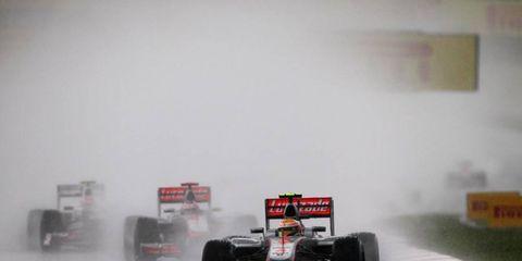 2012 Malaysian Grand Prix: Lewis Hamilton, McLaren MP4-27 Mercedes, leads Jenson Button, McLaren MP4-27 Mercedes, and Sergio Perez, Sauber C31 Ferrari.