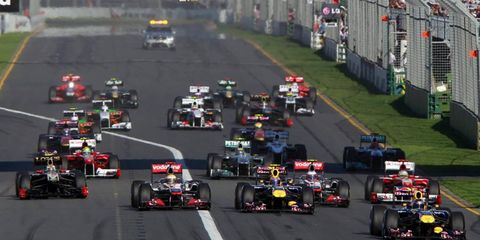 Sebastian Vettel leads the field into turn one at the start of the Australian Grand Prix. Photo by: Charles Coates/LAT Photographic