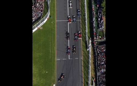 A look from above as the field enters turn one. Photo by: Steven Tee/LAT Photographic