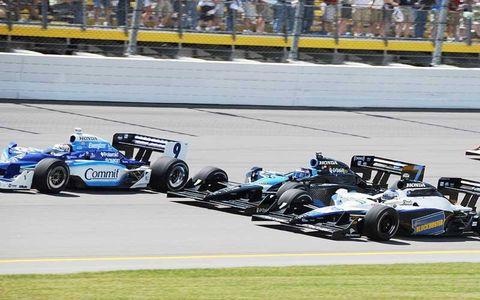 Scott Dixon and Marco Andretti squeeze Danica Patrick for position.