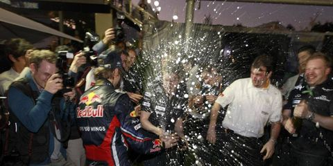 Big Splash Down Under // Formula One driver Sebastian Vettel cracks the bubbly to celebrate his victory at the Australian Grand Prix in Melbourne on March 27. Photo by Charles Coates/LAT Photographic