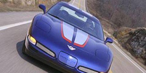 Mode of transport, Automotive design, Road, Automotive mirror, Vehicle, Automotive exterior, Automotive parking light, Infrastructure, Asphalt, Car,