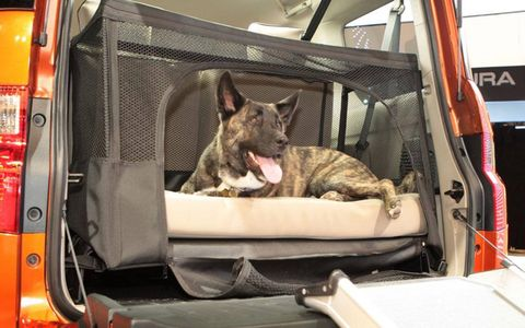 The concept includes a cushioned dog bed in the cargo area.