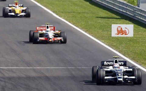 Kazuki Nakajima, Williams FW30 Toyota, 13th position, leads Giancarlo Fisichella, Force India VJM01 Ferrari, 15th position, Nelson Piquet Jr, Renault R28, 6th position, and Jarno Trulli, Toyota TF108, 7th position.