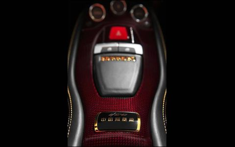 Chinese characters adorn the start button on the special edition 458 Italia.