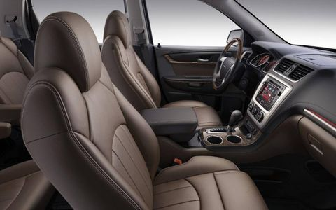 The interior leather of the 2013 GMC Acadia Denali resembles a baseball glove, and conforms just as well.
