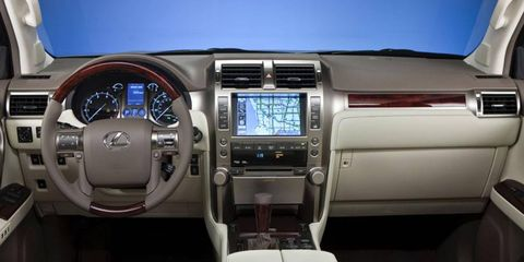 The luxurious interior of the 2013 Lexus GX 460 Limited includes a center-stack navigation system.