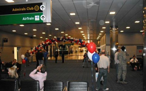 The departure lounge at John F. Kennedy Airport in New York. This scene, with its pomp and circumstance, started two days earlier in Dallas-Fort Worth, the home of American Airlines, which so graciously donated the use of a 767-300 ER jet and crew. The crew, all of whom are veterans of both the airline and the armed services or who have spouses serving, also donated their time.