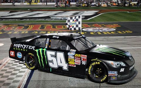 Kyle Busch grabbed the checkers for team owner Joe Gibbs on Friday night.