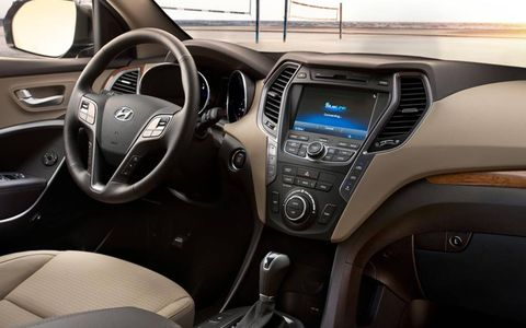 The interior of the 2013 Hyundai Santa Fe Sport is equipped with an optional 8-inch touchscreen, heated steering wheel, and leather-wrapped interior.
