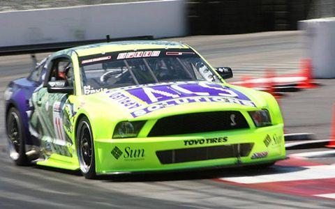 Vehicle, Motorsport, Car, Racing, Auto racing, Vehicle registration plate, Race track, Race car, Hood, Sports car,