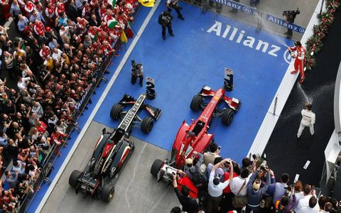 Top finishers Fernando Alonso, right, and Kimi Raikkonen arrive at Parc Ferme in China after the Chinese Grand Prix on Sunday.