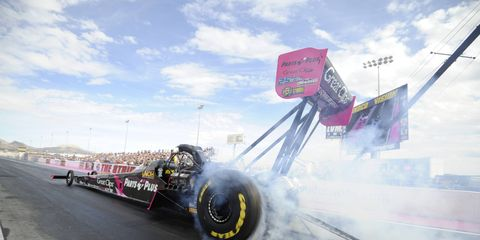 Clay Millican set a track elapsed-time record on his way to the No. 1 qualifying spot in the Top Fuel class at Las Vegas.