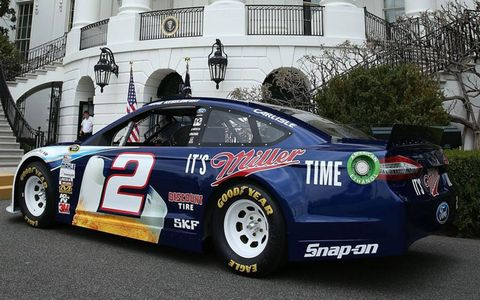 A White House security guard checks out Brad Keselowski's NASCAR Ford Fusion on Tuesday.
