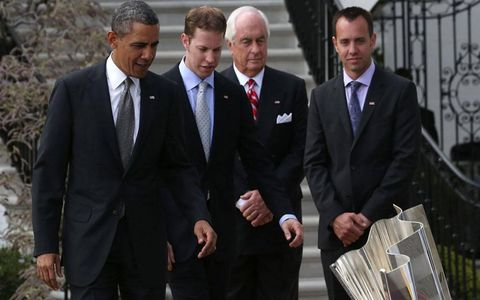 President Obama, Brad Keselowski, team owner Roger Penske and crew chief Paul Wolff admire the NASCAR Sprint Cup Series trophy on the White House grounds on Tuesday.