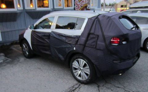It's hard to tell what's under the wrapper, but the Sportage may be due for front and rear fascia updates.