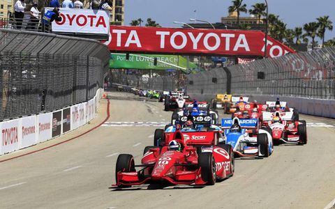 2012 IndyCar Long Beach: Dario Franchitti leads Simon Pagenaud and Josef Newgarden ahead of the field at the start.