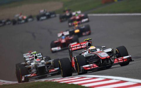 2012 Chinese Grand Prix: Lewis Hamilton, McLaren MP4-27 Mercedes, leads Sergio Perez, Sauber C31 Ferrari.