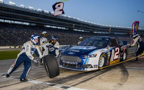 Defending series champion Brad Keselowski sits stationary as his crew performs a pit stop. Photo by Action Sports Photography