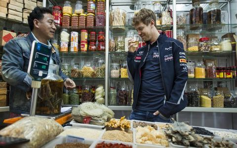FUELING UP //  Three-time Formula One champion Sebastian Vettel checks out the local cuisine in Shanghai, China, before the 2013 Grand Prix of China. Photo by RedBull Media