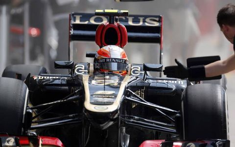 Romain Grosjean awaits the signal to leave the Lotus pit stall during Friday's practice session at the Shanghai International Circuit. Photo by Alastair Staley/LAT Photographic