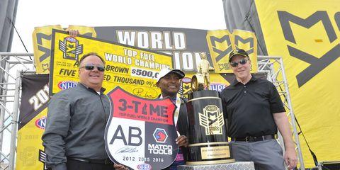 Antron Brown, center, celebrates his 2016 NHRA Mello Yello Series Top Fuel championship.