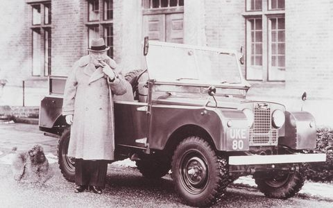 Two British Icons: Prime Minister Winston Churchill stands next to his Land Rover Series I.