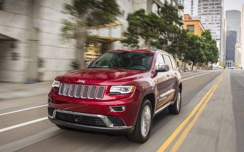The 2014 Jeep Grand Cherokee diesel has a range of 738 miles with an EPA highway rating of 30 mpg on the highway and a tank that holds 24.6 gallons. Grand Cherokee Summit shown.