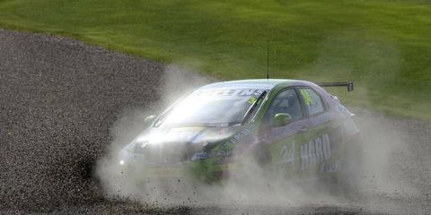 Dirt devil: Tony Gilham finds the kitty litter in his Honda Civic during the British Touring Car Championship event at Donington Park in England.