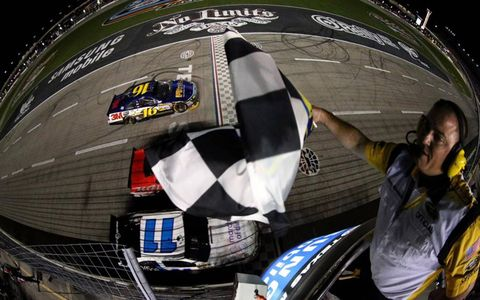 Outta the way: Backmarkers clear a path for Greg Biffle as he crosses the line to win the NASCAR Sprint Cup Series race at Texas Motor Speedway.