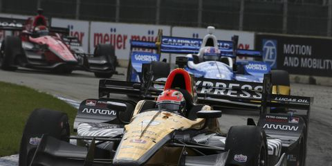 James Hinchcliffe leads a group through turn one during Race 1 of the Chevrolet Detroit Grand Prix.