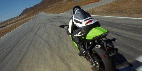 Motorcycle, Automotive tire, Automotive design, Motorcycle racing, Motorcycling, Motorcycle helmet, Motorcycle fairing, Motorsport, Fender, Automotive lighting,