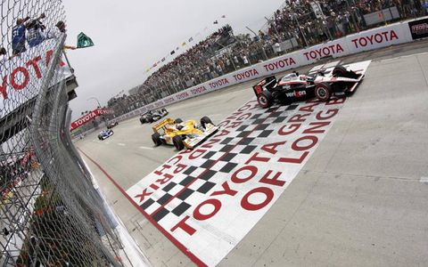 Will Power (right) and Ryan Hunter-Reay (left) lead the field at the start of the Grand Prix of Long Beach on April 17. Photo by: Michael L. Levitt LAT Photo