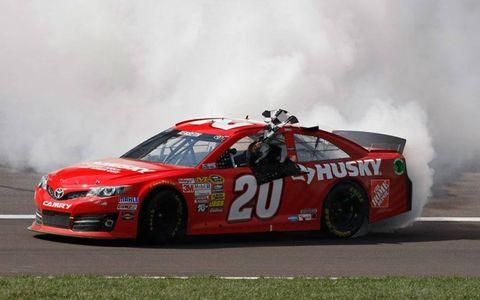 Matt Kenseth grabbed the checkered flag at Kansas following the NASCAR Sprint Cup Series win.