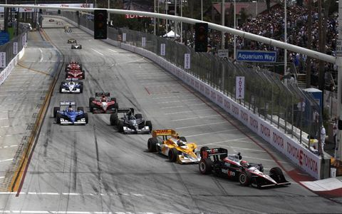 Power leads a train of cars into turn one. Photo by: Michael L. Levitt LAT Photo