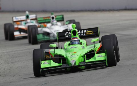 Danica Patrick leads Simone De Silvestro and Charlie Kimball down the front stretch in Long Beach. Photo by: Phillip Abbott LAT Photo