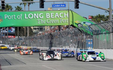 The No. 16 Dyson Lola-Mazda and the No. 6 Aston Martin head for the green flag in Long Beach, Calif., on April 16. Photo by: Dan R. Boyd LAT