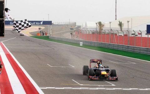 Sebastian Vettel of Red Bull Racing takes the checkered flag in Bahrain on Sunday.