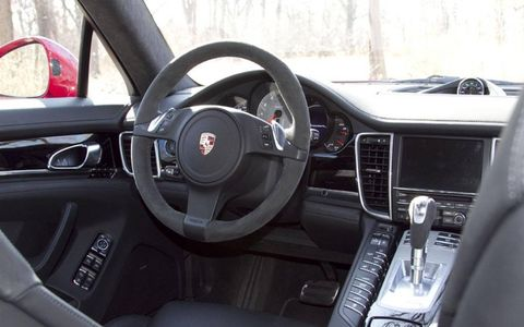 The interior of the 2013 Porsche Panamera S Hybrid is luxurious and roomy, with the center stack loaded with gadgetry.