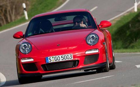 Automotive design, Road, Vehicle, Red, Car, Performance car, Asphalt, Sports car, Road surface, Bumper,